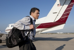 Texas Gov. Rick Perry departs a private plane at the San Antonio International Airport during a campaign stop on November 1, 2010