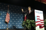 Texas Governor Rick Perry gestures during his speech to the NAELO  National Assn. of Latino Elected Officials in San Antonio on June 23, 2011.