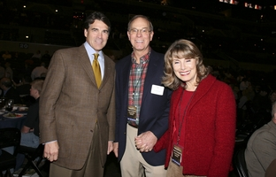 Gov Rick Perry, l, poses for a photograph with James Leininger and wife Ceceile at a San Antonio event on November 15, 2007.