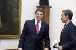 Gov. Rick Perry, l, talks with House Speaker Joe Straus, r, following a Cash Management Committee meeting at the Capitol on July 19, 2011.