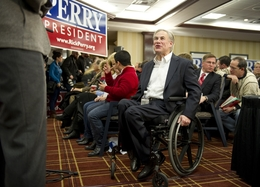 """Texas Attorney General Greg Abbott on Jan. 3, 2012, greeting members of the Texas """"strike force"""" in Iowa to support Gov. Rick Perry's presidential bid."""