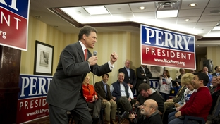 Rick Perry rallies the Texas strike force troops gathered at the Sheraton West Des Moines on January 3, 2012.