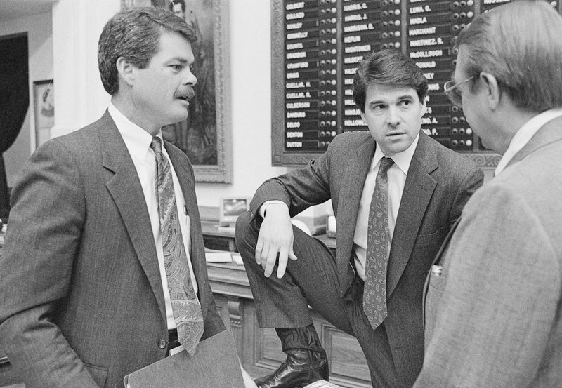 Rep. Rick Perry with Rep. Pete Laney and Rep. Ron Lewis the floor of the house during the 71st Legislative session, April 13, 1989.