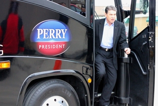 Perry getting off his Faith, Jobs and Freedom 2nd look tour bus.