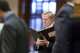 State Rep. Jim Pitts, R-Waxahachie, holds his bill book while listening to evening debate on SB1811 in the Texas House on May 20, 2011.