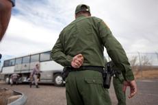 Border Patrol officers outside a bus in Presidio.