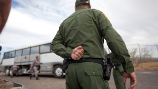 Border Patrol officers outside a bus in Presidio.
