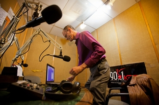 David Babb, the host of the Prison Show broadcast from KPFT, prepares to go on the ari in Houston Friday Feb 24, 2012.