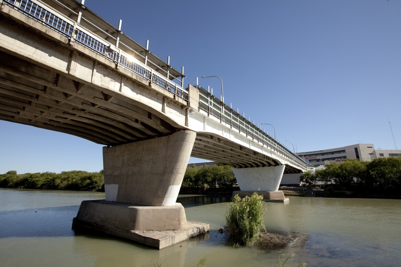 Laredo, Texas Octoer 17, 2009: International Bridge No. 1 spans the Rio Grande looking at Nuevo Laredo, Mexico from the banks of a city park in Laredo, TX.