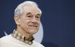 Ron Paul smiles while onstage at an airport rally in Charleston, S.C. on January 20, 2012.