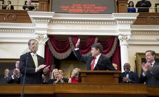 Flanked by state leaders, Gov. Perry begins his State of the State speech on January 29, 2013