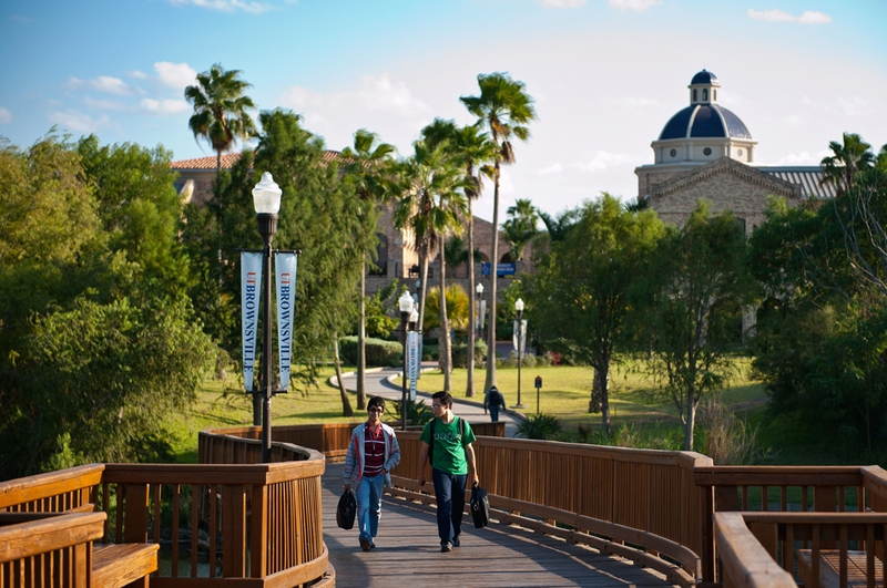 Students cross a bridge over a resaca on the University of Texas Brownsville and Texas Southmost College campuses on Monday.