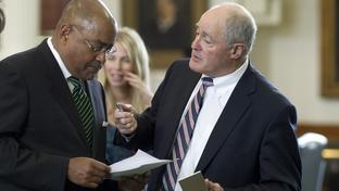 Sen. Kel Seliger (r), R-Amarillo, solicits support from Sen. Rodney Ellis (l), D-Houston, during Senate action on March 29, 2011.
