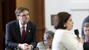 Sen. Dan Patrick (l), R-Houston, listens to an amendment by Sen. Leticia Van de Putte, D-San Antonio, during the debate on HB15 on May 2, 2011.