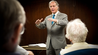 Texas State Sen. Kirk Watson, D-Austin, presents his plans for a medical school before the West Austin Democrats.