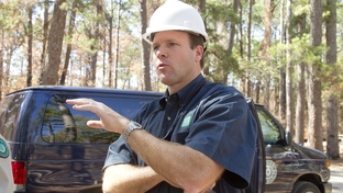 Executive Director of the Texas Parks and Wildlife Dept, Carter Smith, speaks to visitors at Bastrop State Park about the restoration efforts following wildfires on October 13, 2011.