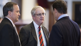 State Rep. John Smithee (c), R-Amarillo, listens to Texas Gov. Rick Perry (r) on the House floor on May 28, 2011.