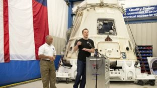 SpaceX CEO Elon Musk, right, at the return of the Dragon spacecraft with NASA chief Charles Bolden, left, on June 13, 2012.