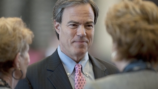 House Speaker Joe Straus talks to members prior to a debate on HB15 the sonogram bill on March 2, 2011