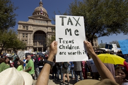 A protester's sign asks for a tax increase to fund Texas public education at the Save Our Schools rally on March 12, 2011.
