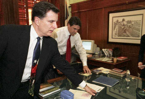 Mike Toomey (l), former chief of staff for Texas Governor Rick Perry (r) with the governor on January 21, 2003 in his office on the eve of his second inaugural.  Toomey, now a high-powered lobbyist, and Perry have been friends since their first days in politics.