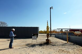 Texas Railroad Commission lead engineering technician for districts 1 and 2, Michael Polasek, inspects a salt water disposal injection well at a Heckman Water Resources commercial disposal facility on the LAMZA lease near Highway 80, January 22, 2012.