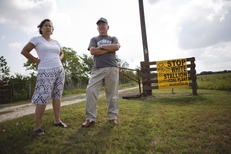 Robert Malina and Eva Malina have an anti coal sign at the entrance to their property and home near Bay City, Texas Monday, June 13, 2011 which is within sight of the planned White Stallion coal-fired power plant on the Colorado River.