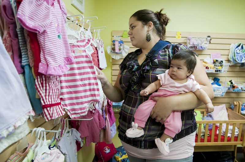 Gabriella States shops for her children Mario (age 2) and Jazmin (2 months) in Austin Life Care's baby clothes boutique.