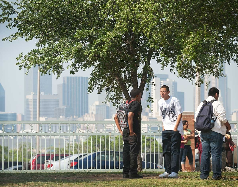 Students at Townview wait for the bus on Tuesday in South Dallas.