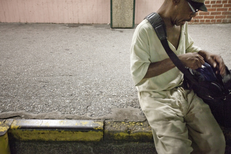 53-year-old Acy Williams checks that he has all of his belongings shortly after being released from the Harris County Jail on Thursday, August 11, 2011. Williams, who often sleeps on the Houston streets, wandered around the blocks surrounding the jail waiting for his girlfriend to be released.