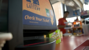 """Check your ticket"" lottery machine in an Austin, TX gas station."