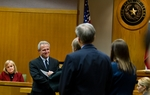 Michael Morton receives the document officially clearing his name of the murder of his wife in a Williamson County courtroom Dec. 19.