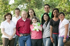 A 2011 photo of Melissa and Gary Gates with seven of their 13 children on the Gates' 150-acre property in Richmond, Texas. From left to right: Melissa, Marcus, Gary, Cassie, Sarah, Cynthia, Andy, Raquel and Lexi.
