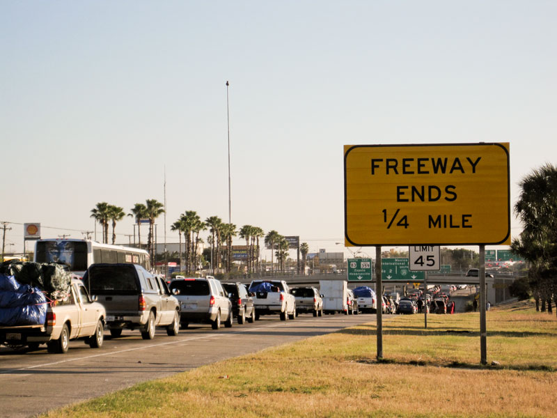 "Thousands of motorists wait in line on the southernmost stretch of IH-35 in Laredo, Texas. Despite a global recession and escalating violence in Mexico thousands of ""paisanos"" still made the trek south for Christmas. As the hours passed, however, their concerns about traveling Mexico's highways at night grew. A recent prison break in Nuevo Laredo didn't help soothe their fears about bandits lurking on the roadways. ""We might have to get a hotel here,"" said one traveler."