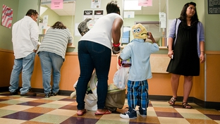 Patients are shown checking out in 2010 at the People's Community Clinic in Austin, a safety-net clinic that serves Medicaid recipients and the underinsured.