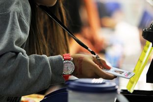 Students scan their radio frequency identification tags as they pass through the lunch line at Jones Middle School in San Antonio, September 14, 2012.