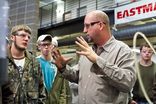 Students listen to their instructor, Curtis Collins, during their Pumps, Compressors and Mechanical Drives class at Texas State Technical College Waco.