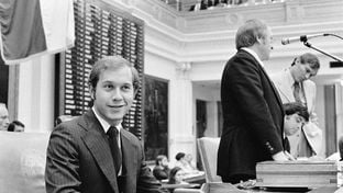 Whitmire at the front of the House chamber during the 64th session in 1975. House Speaker Billy Clayton is at the podium.