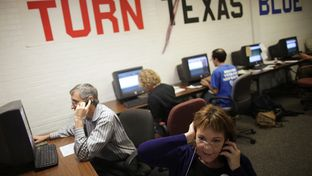 Travis County Democratic Party volunteers make calls to voters on Election Day from the coordinated campaign headquarters in Austin, Texas.