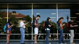 Voters wait in line to cast their ballots at the Flawn Academic Center on the University of Texas at Austin campus on Nov. 6, 2012.