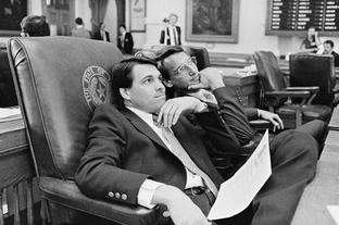 State Rep. Robert Earley (D-Portland) and Rep. Rick Perry on the floor of the House during the 69th Legislative session, May 15, 1985.