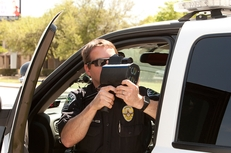 Austin Police Department Senior Patrol officer S. Boughton uses radar to monitor vehicles along stretch of Austin highway in 2011.