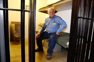Jim Willett is the director of the Texas Prison Museum and was a warden at the Walls Unit who oversaw 89 executions by lethal injection. He sits in a replica cell within the museum.