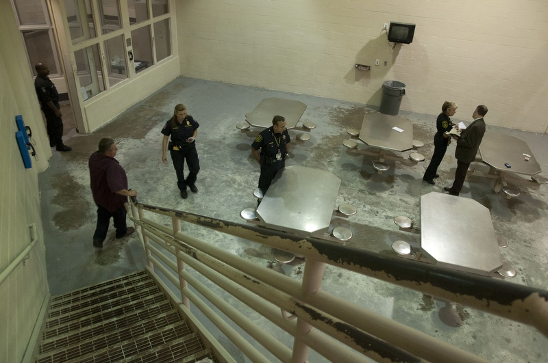 Inspectors testing the emergency ventilation of the unit for fire code compliance tests at Dallas County Jail.