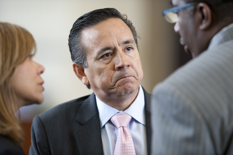 State Sen. Carlos Uresti, D-San Antonio, listens to colleagues on the Senate floor on April 19, 2011.