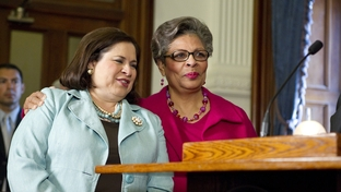 State Sen. Leticia Van de Putte, D-San Antonio, stands with state Rep. Senfronia Thompson, D-Houston, on May 25, 2011, as Gov. Rick Perry ceremonially signs HB 3000, a bill increasing the penalties on human trafficking.