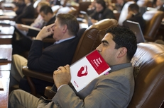 State Rep. Armando Walle, D-Houston, with a copy of the Texas House Practice rule book as he listens to debate on SB1811, the fiscal matters bill, on May 29, 2011.
