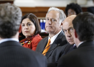 Senators Leticia Van de Putte (l), Kirk Watson (c) and John Whitmire (r) listen to David Campbell of Luminant at a public hearing on power outages on February 15, 2011.
