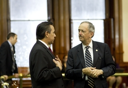With rain pouring down outside the Senate chamber, State Sen. Jeff Wentworth (r), R-San Antonio, speaks with State Sen. Carlos Uresti, D-San Antonio, on May 20, 2011.