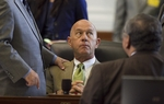 State Sen. John Whitmire, D-Houston, listens to colleagues while listening in the Senate chamber on June 27, 2011.